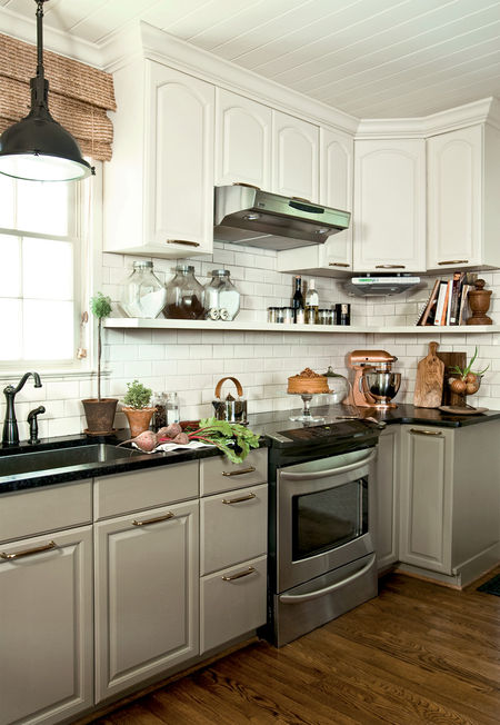 love the contrasting cabinet colors and the under-cabinet shelf
