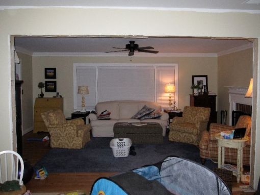 looking into the living room from the future kitchen/dining space