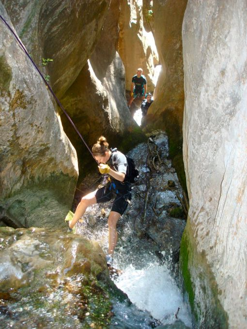 rapelling down the face of one of the many waterfalls